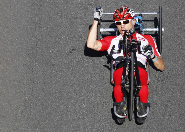 Poland's Rafal Wilk celebrates winning the Men's Individual H3 - Road Race during the London 2012 Paralympic Games, at Brands Hatch racing track in southeast England September 6, 2012. In the H3 class category, athletes have impairments to their legs and race using a hand-cycle. (Luke MacGregor/Reuters)