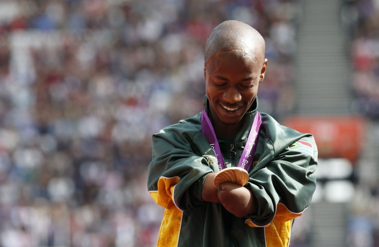 South Africa's Radebe Samkelo looks at his gold medal which he received for the men's 4 x 100 relay - T42-46 in the Olympic Stadium at the London 2012 Paralympic Games September 6, 2012. (Suzanne Plunkett/Reuters)