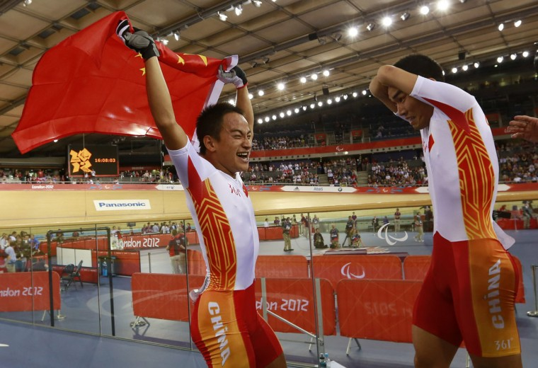 Xie Hao (L) and Xiaofei Ji of China's track cycling team celebrate after winning Gold in the Mixed C 1 to 5 Team Sprint Gold Medal Final at the London 2012 Paralympic games in the Velodrome, at the Olympic Park in Stratford, London September 2, 2012. In the C class competition, athletes with an impairment that affects their legs, arms and/or trunk compete using a standard bicycle, the number indicates the level of impairment with 1 being the most impaired and 5 the least. (Olivia Harris/Reuters)