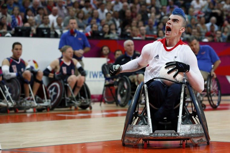 Britain's David Anthony celebrates after scoring a goal during their Wheelchair Rugby match against the U.S. during the London 2012 Paralympic Games at the Olympic Stadium in London, September 5, 2012. (Stefan Wermuth/Reuters)