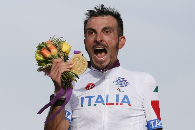 Italy's Roberto Bargna celebrates after receiving his gold medal for the men's individual C 1-3 road race during the London 2012 Paralympic Games at Brands Hatch racing circuit near Sevenoaks September 6, 2012. (Stefan Wermuth/Reuters)
