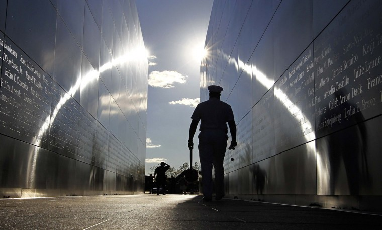 """A serviceman walks through the """"Empty Sky"""" memorial dedicated to the victims of the attack on the World Trade Center at Liberty State Park in Jersey City, September 10, 2012. New York will mark the 11th anniversay of the attack on the World Trade Center with ceremonies on Tuesday. (Gary Hershorn/Reuters)"""
