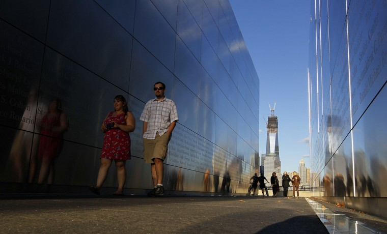 """People walk through the """"Empty Sky"""" memorial dedicated to the victims of the attack on the World Trade Center at Liberty State Park in Jersey City, New Jersey, September 10, 2012. New York will mark the 11th anniversary of the attack on the World Trade Center with ceremonies on Tuesday. (Gary Hershorn/Reuters)"""