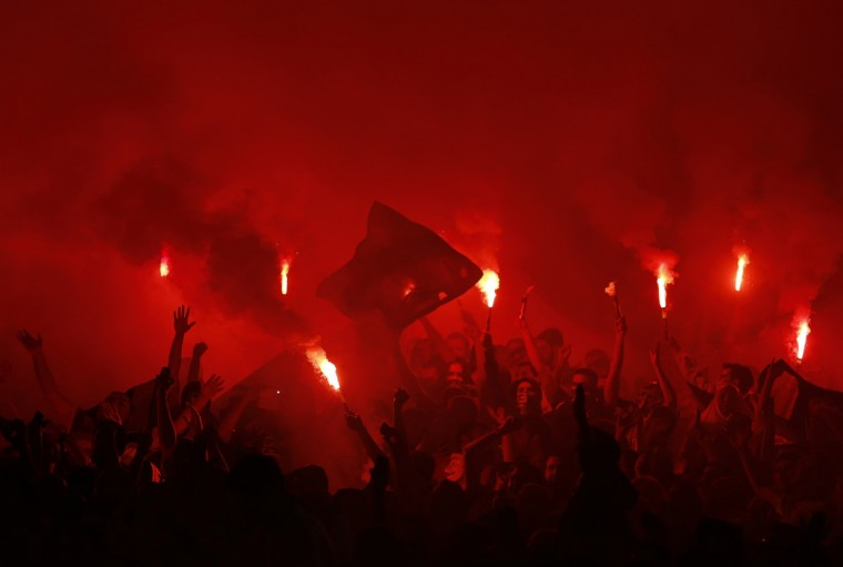 Fenerbahce fans light flares during the Europa League Group C soccer match between Fenerbahce and Olympique Marseille at Sukru Saracoglu stadium in Istanbul. (Murad Sezer/Reuters)