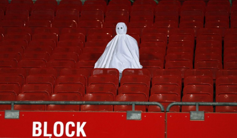 A dummy ghost sits in the empty tribune prior to the Europa League Group K soccer match between SK Rapid Wien and Rosenborg BK in Vienna. Rapid Wien must play this match behind closed doors as a result of crowd trouble after their Europa League qualifier at PAOK Salonika in August. (Leonhard Foeger/Reuters)