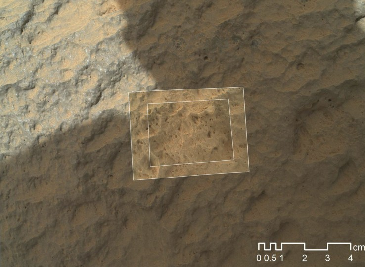 "September 23, 2012: This image combines photographs taken by the Mars Hand Lens Imager (MAHLI) at three different distances from the first Martian rock that NASA's Curiosity rover touched with its arm, taken during the 47th Martian day, or sol, of Curiosity's work on Mars. The team has named the target rock ""Jake Matijevic."" MAHLI reveals that the target rock has a relatively smooth, gray surface with some glinty facets reflecting sunlight and reddish dust collecting in recesses in the rock. (NASA/JPL-Caltech/MSSS/Handout/Reuters)"