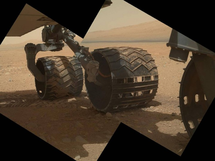 September 9, 2012: The three left wheels of NASA's Mars rover Curiosity are shown here combined in two images that were taken by the rover's Mars Hand Lens Imager (MAHLI). In the distance is the lower slope of Mount Sharp. (NASA/JPL-Caltech/Malin Space Science Systems/Handout/Reuters)