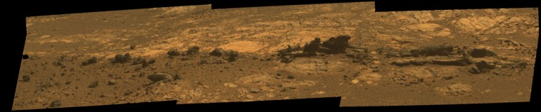 August 23, 2012: Rock fins up to about 1 foot (30 centimeters) tall are visible in this panoramic camera image by NASA's Mars Exploration Rover Opportunity. The view spans an area of terrain about 30 feet (9 meters) wide. Orbital investigation of the area has identified a possibility of clay minerals in this area of the Cape York segment of the western rim of Endeavour Crater. The view combines exposures taken through Pancam filters centered on wavelengths of 753 nanometers (near infrared), 535 nanometers (green) and 432 nanometers (violet). It is presented in approximate true color, the camera team's best estimate of what the scene would look like if humans were there and able to see it with their own eyes. (NASA/JPL-Caltech/Cornell Univ./Arizona State Univ./Handout/Reuters)