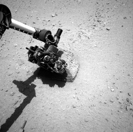 September 22, 2012: The robotic arm of the Mars rover Curiosity makes contact with the first rock touched by the Alpha Particle X-Ray Spectrometer instrument. The rover placed the instrument onto the rock to assess what chemical elements were present in the rock. (NASA/JPL-Caltech/Handout/Reuters)