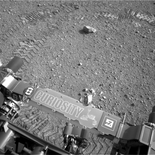 August 28, 2012: The wheel tracks of the Mars Curiosity rover are seen in the dust on Mars. A close inspection of the tracks reveals a unique, repeating pattern: Morse code for JPL. This pattern, visible as straight bands across the zigzag track marks, can be used as a visual reference to help the rover drive accurately. (NASA/JPL-Caltech/Handout/Reuters)