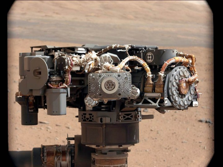 September 7, 2012: Curiosity's Mast Camera, the Alpha Particle X-Ray Spectrometer (APXS) on NASA's Curiosity rover, is shown with the Martian landscape in the background on the 32nd Martian day, or sol, of operations on the surface. This image lets researchers know that the APXS instrument had not become caked with dust during Curiosity's dusty landing. Scientists enhanced the color in this version to show the Martian scene as it would appear under the lighting conditions we have on Earth, which helps in analyzing the terrain. (NASA/JPL-Caltech/MSSS/Handout/Reuters)