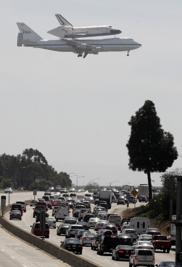 Traffic comes to a standstill on the southbound 405 freeway as the Space Shuttle Endeavour arrives on the back of a NASA 747 Shuttle Carrier Aircraft as it passes over the 405 freeway in Los Angeles on its landing approach to Los Angeles International Airport September 21, 2012. The Shuttle Endeavour will be put on display at the California Science Center in mid-October 2012. (Fred Prouser/Reuters)