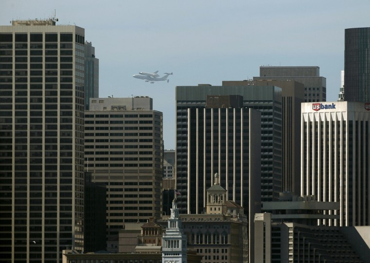 The Space Shuttle Endeavour flies on the back of a 747 over downtown San Francisco en route to Los Angeles International Airport September 21, 2012. (Beck Diefenbach/Reuters)