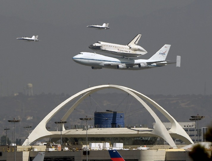 The Space Shuttle Endeavour conducts a flyover on the back of a 747 before making its final touchdown at the Los Angeles International Airport, September 21, 2012. Endeavour will be moved to its permanent home at the California Science Center mid-October. (Gene Blevins/Reuters)