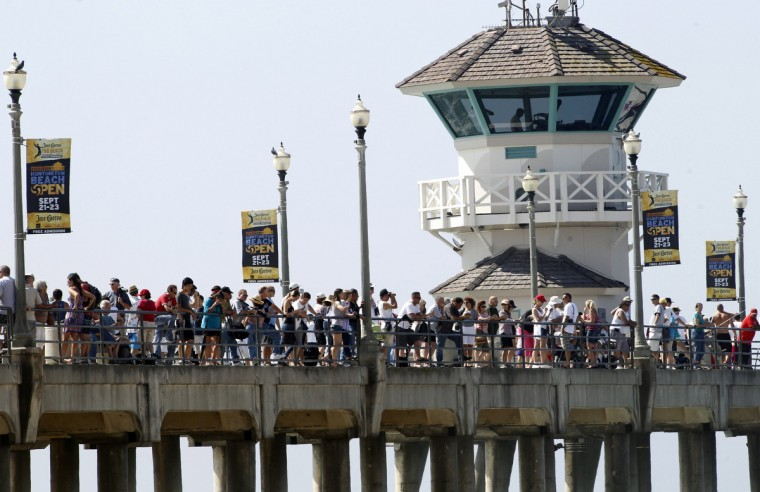 Hundreds of people wait at the Huntington Beach Pier for the Space Shuttle Endeavour to arrive on the back of a 747 en route to Los Angeles International Airport September 21, 2012. Endeavour will be moved to its permanent home at the California Science Center mid-October. (Alex Gallardo/Reuters)