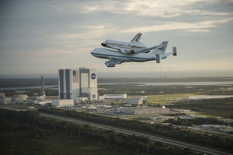 The space shuttle Endeavour, atop NASA's Shuttle Carrier Aircraft, flies over the Kennedy Space Center in Cape Canaveral, Florida on September 19, 2012. (NASA)