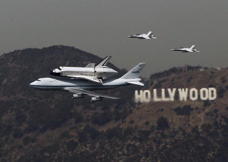 The Space Shuttle Endeavour is escorted by two F-18 jets as it passes the Hollywood sign on the back of a NASA 747 in Los Angeles September 21, 2012. (Mike Blake/Reuters)