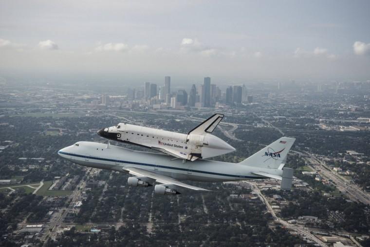 The space shuttle Endeavour, atop NASA's Shuttle Carrier Aircraft, flies over Houston, Texas on September 19, 2012. (NASA)