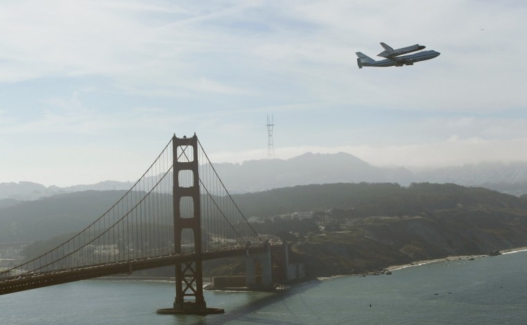 Retired space shuttle Endeavour is carried on the back of a NASA jet as it approaches the Golden Gate Bridge in San Francisco, California September 21, 2012. Endeavour will be moved to its permanent home at the California Science Center mid-October. (Robert Galbraith/Reuters)