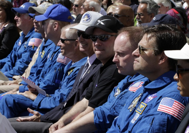 Astronauts sit together during a ceremony for the arrival of Space Shuttle Endeavour on the back of a 747 at Los Angeles International Airport September 21, 2012. Endeavour will be moved to its permanent home at the California Science Center mid-October. (Jonathan Alcorn/Reuters)