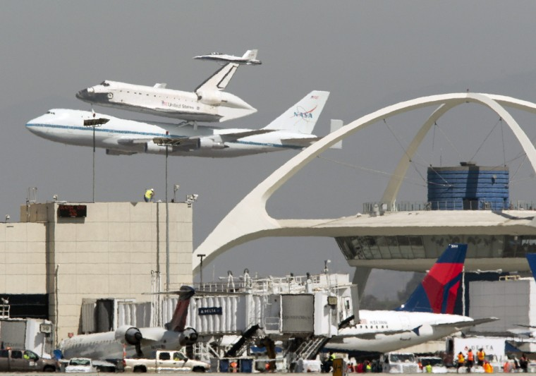 The Space Shuttle Endeavour does a flyby of Los Angeles International Airport on the back of a 747 before making flybys at other locations in Los Angeles, California September 21, 2012. (Jason Redmond/Reuters)