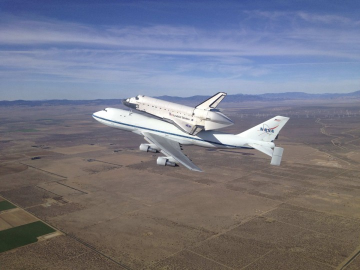 The Space Shuttle Endeavour atop its modified 747 carrier aircraft soars over the California high desert west of the towns of Rosamond and Mojave, California. (NASA)