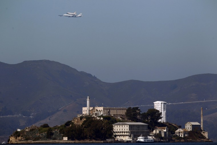 The Space Shuttle Endeavour flies on the back of a 747 over Alcatraz Island in San Francisco en route to Los Angeles International Airport September 21, 2012. The space shuttle Endeavour, bolted to the top of a jumbo jet, took off on Friday from Edwards Air Force Base for a last airborne victory lap over California en route to its final frontier and retirement home - a science museum in Los Angeles. (Beck Diefenbach/Reuters)