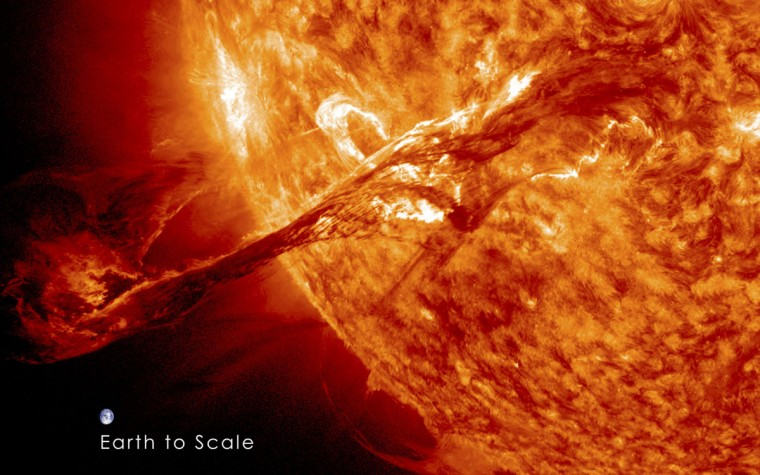 A long filament of solar material that had been hovering in the Sun's atmosphere, the corona, erupts out into space at 4:36 p.m. EDT on August 31, 2012. The coronal mass ejection, or CME, traveled at over 900 miles per second. The CME did not travel directly toward Earth, but did connect with Earth's magnetic environment, or magnetosphere, causing aurora to appear on the night of September 3, 2012. The image includes an image of Earth to show the size of the CME compared to the size of Earth. (NASA/GSFC/SDO/Reuters)