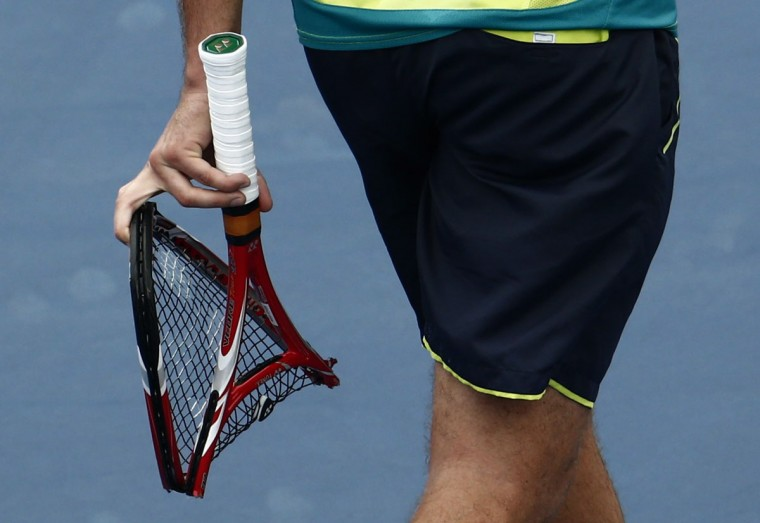 Stanislas Wawrinka of Switzerland carries his broken racquet during his men's singles match against Novak Djokovic of Serbia at the U.S. Open tennis tournament in New York September 5, 2012. (Eduardo Munoz/Reuters)
