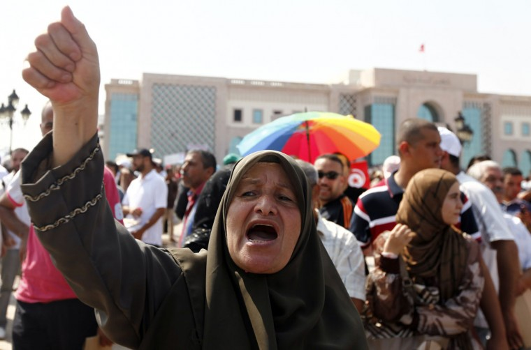 A protester shouts slogans during a demonstration in support of the ruling Ennahada party in Tunis. (Anis Mili/Reuters)