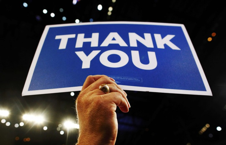 """A delegate holds a """"thank you"""" sign while honoring American military personnel during the final session of the Democratic National Convention in Charlotte, North Carolina September 6, 2012. (Eric Thayer/Reuters)"""