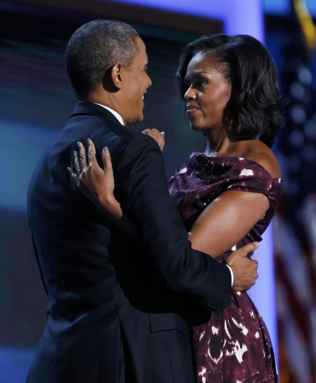 U.S. President Barack Obama hugs his wife Michelle Obama prior to addressing the final session of the Democratic National Convention in Charlotte, North Carolina September 6, 2012. (Eric Thayer/Reuters)