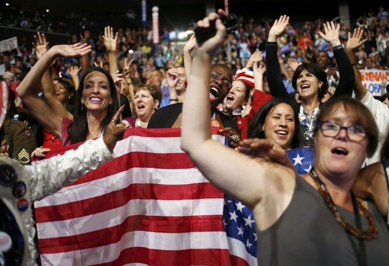 "Delegates from Massachusetts dance to the song ""Freedom!"" during the final session of the Democratic National Convention in Charlotte, North Carolina, September 6, 2012. (Adrees Latif/Reuters)"