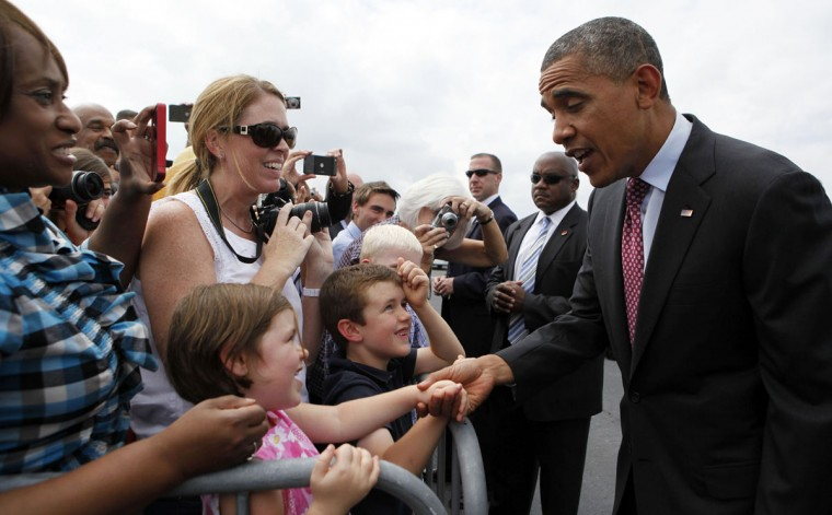 U.S. President Barack Obama shakes hands after arriving at North Carolina Air National Guard base in Charlotte. Obama is in North Carolina to speak at the 2012 Democratic National Convention tomorrow night. (Larry Downing/Reuters)