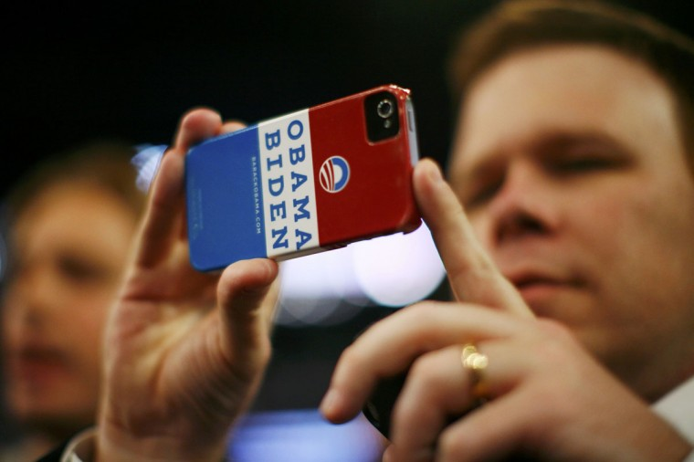 A delegate holds his mobile phone during the final session of the Democratic National Convention in Charlotte, North Carolina September 6, 2012. (Eric Thayer/Reuters)