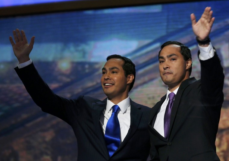 Keynote speaker and San Antonio, Texas Mayor Julian Castro (L) waves along with his brother Joaquin Castro before addressing the first session of the Democratic National Convention in Charlotte, North Carolina, September 4, 2012. (Jim Young/Reuters)