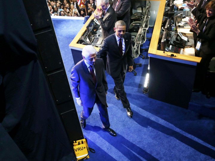 U.S. President Barack Obama (R) and former President Bill Clinton (L) walk off stage after Clinton addressed the second session of the Democratic National Convention in Charlotte, North Carolina September 5, 2012. (Rick Wilking/Reuters)