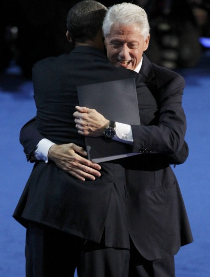 Former U.S. President Bill Clinton (R) hugs U.S. President Barack Obama after he nominated Obama for re-election during the second session of the Democratic National Convention in Charlotte, North Carolina, September 5, 2012. (Jonathan Ernst/Reuters)