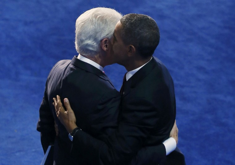 U.S. President Barack Obama speaks in former President Bill Clinton's ear after Clinton nominated him for re-election during the second session of the Democratic National Convention in Charlotte, North Carolina, September 5, 2012. (Rick Wilking/Reuters)