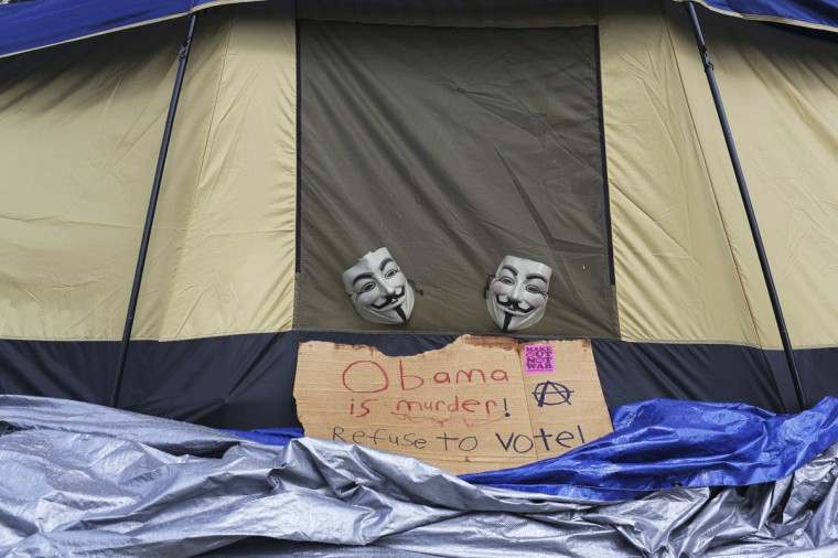 Guy Fawkes masks are hung on the side of a tent where protesters were camped out for the start of the Democratic National Convention in Charlotte, North Carolina September 3, 2012. (Philip Scott Andrews/Reuters)