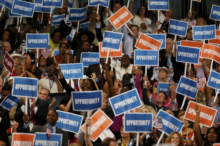 Delegates wave campaign signs during the first session of the Democratic National Convention in Charlotte, North Carolina, September 4, 2012. (Eric Thayer/Reuters)