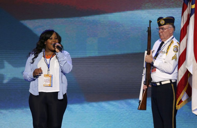 "Actress and singer Amber Riley, of the television show ""Glee,"" sings the U.S. National Anthem during a rehearsal with a member of the color guard from the Disabled American Veterans, ahead of the first day of the Democratic National Convention in Charlotte, North Carolina, September 4, 2012. (Jason Reed/Reuters)"