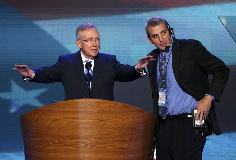 Senate Majority Leader Harry Reid (D-NV) talks with a member of the production staff (R) during a walk through ahead of the first day of the Democratic National Convention in Charlotte, North Carolina, September 4, 2012. (Jason Reed/Reuters)