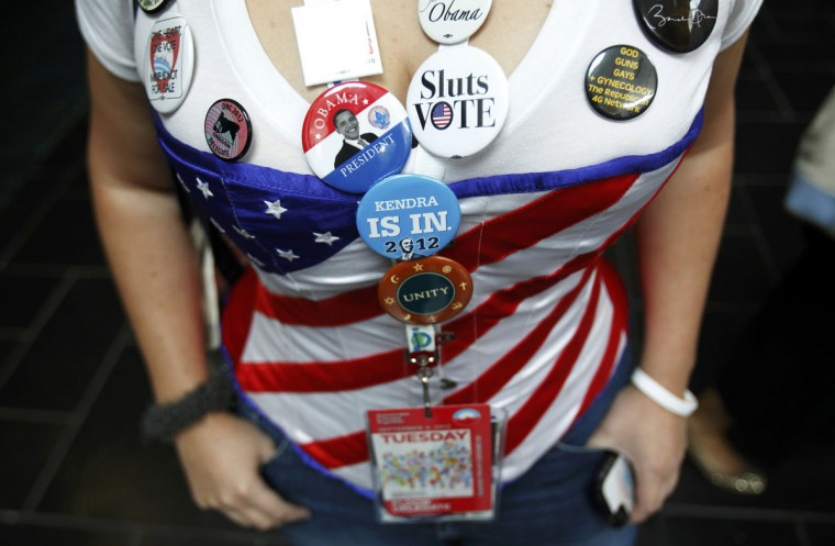 Oregon delegate Kendra Murray poses with numerous buttons as she attends the first day of the Democratic National Convention in Charlotte, North Carolina, September 4, 2012. (Jason Reed/Reuters)