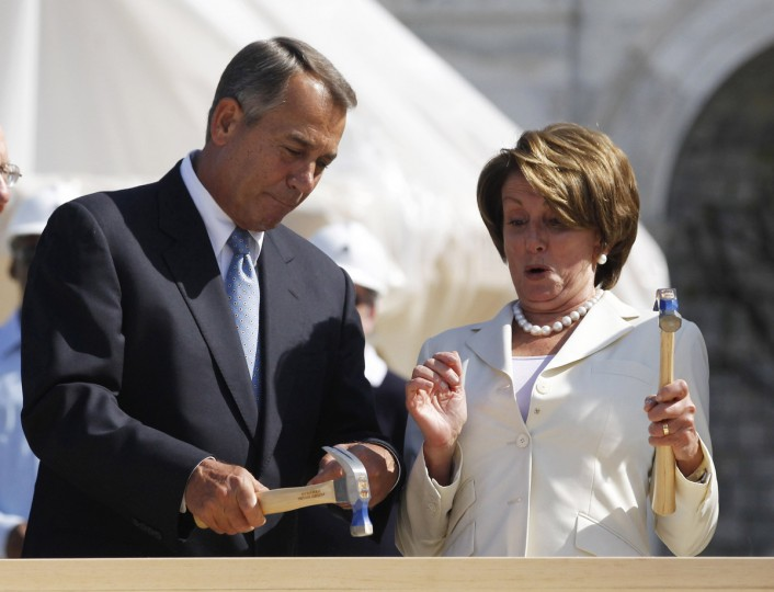 U.S. House Minority Leader Nancy Pelosi (D-CA) reacts as U.S. House Speaker John Boehner (L) (R-OH) helps hammer in her nail during a ceremony for the Presidential inauguration construction on the west front of the U.S. Capitol in Washington. Either Barack Obama or Mitt Romney will be sworn in as U.S. President in a private ceremony on Sunday, January 20, 2013, with the official public inauguration taking place the next day at the U.S. Capitol. (Jason Reed/Reuters)