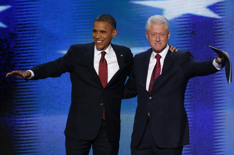 U.S. President Barack Obama (L) joins former President Bill Clinton onstage after Clinton nominated Obama for re-election during the second session of the Democratic National Convention in Charlotte, North Carolina, September 5, 2012. (Jason Reed/Reuters)