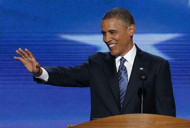 U.S. President Barack Obama waves as he arrives to address delegates during the final session of the Democratic National Convention in Charlotte, North Carolina, September 6, 2012. (Jason Reed/Reuters)