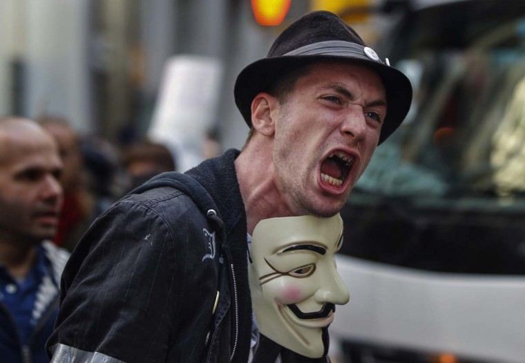 An Occupy Wall Street activist screams as he demonstrates in the financial district during the one-year anniversary of the movement in New York. (REUTERS/Lucas Jackson)