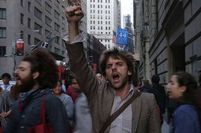 Occupy Wall Street activists shout slogans and march in Lower Manhattan's financial district on the one-year anniversary of the movement in New York. (REUTERS/Adrees Latif)