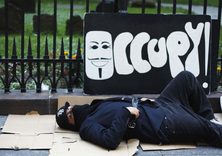 A Occupy Wall Street activist sleeps on the sidewalk before planned demonstrations in the financial district during the one-year anniversary of the movement in New York. (REUTERS/Lucas Jackson)